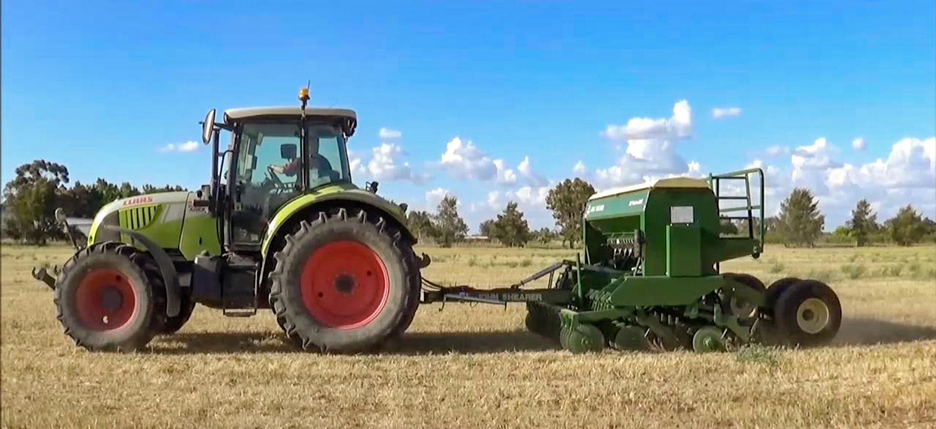3.5m Pasture Drill towed by a Claas tractor