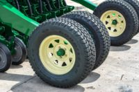 Dual depth wheels for superior floatation and consistent seeding depth