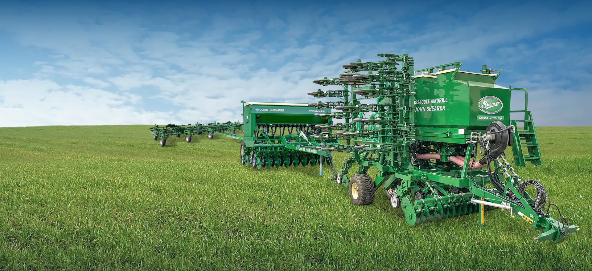 AS2400LT Airdrill, 3.0m Pasture Drill and Mk 3 Universal Seeder Bar in a green field